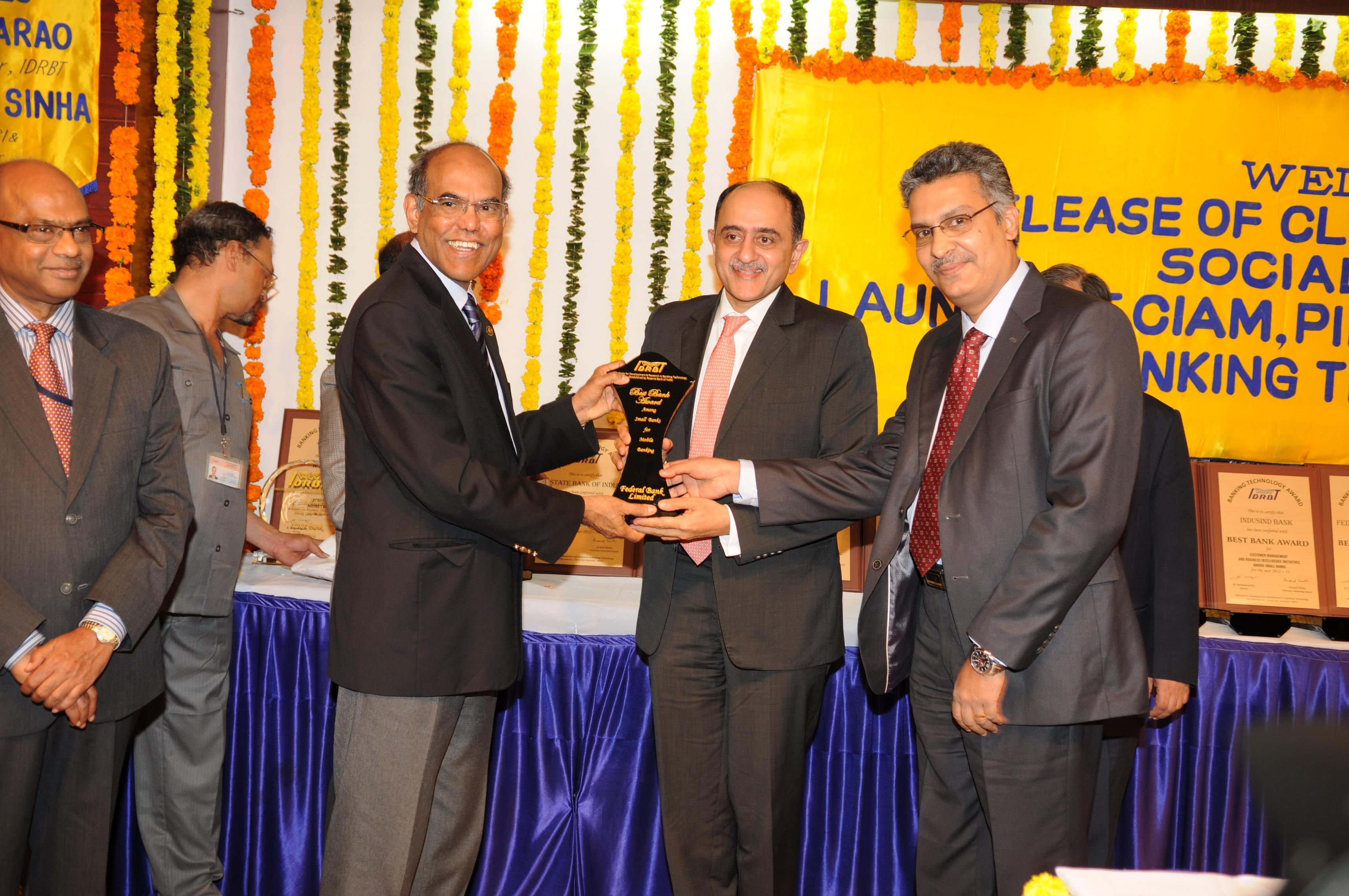 IDRBT Awards for Excellence in Banking Technology 2012-13 - Federal Bank won two IDRBT Awards for Excellence in Banking Technology for the year 2012-13 for Best IT Team and Best Mobile Banking in the small bank category. Seen in the picture are Shri .Shyam Srinivasan ,MD & CEO and Shri .Sunny K P,DGM and Head-IT and Operations receiving the awards at a function held at Hyderabad from the RBI Governor, Dr. D Subbarao. These twin awards are the latest of a long series of regular wins Federal Bank had at The Institute for Development & Research in Banking Technology. (IDRBT was established by the Reserve Bank of India in 1996 as an Autonomous Centre for Development and Research in Banking Technology).